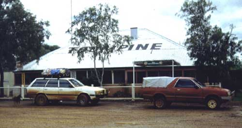 At Toompine (SW Qld) after a bit of muddy road. This and the one below show the rag canopy we added for the 1993 Across Australia trip. & Red Rova